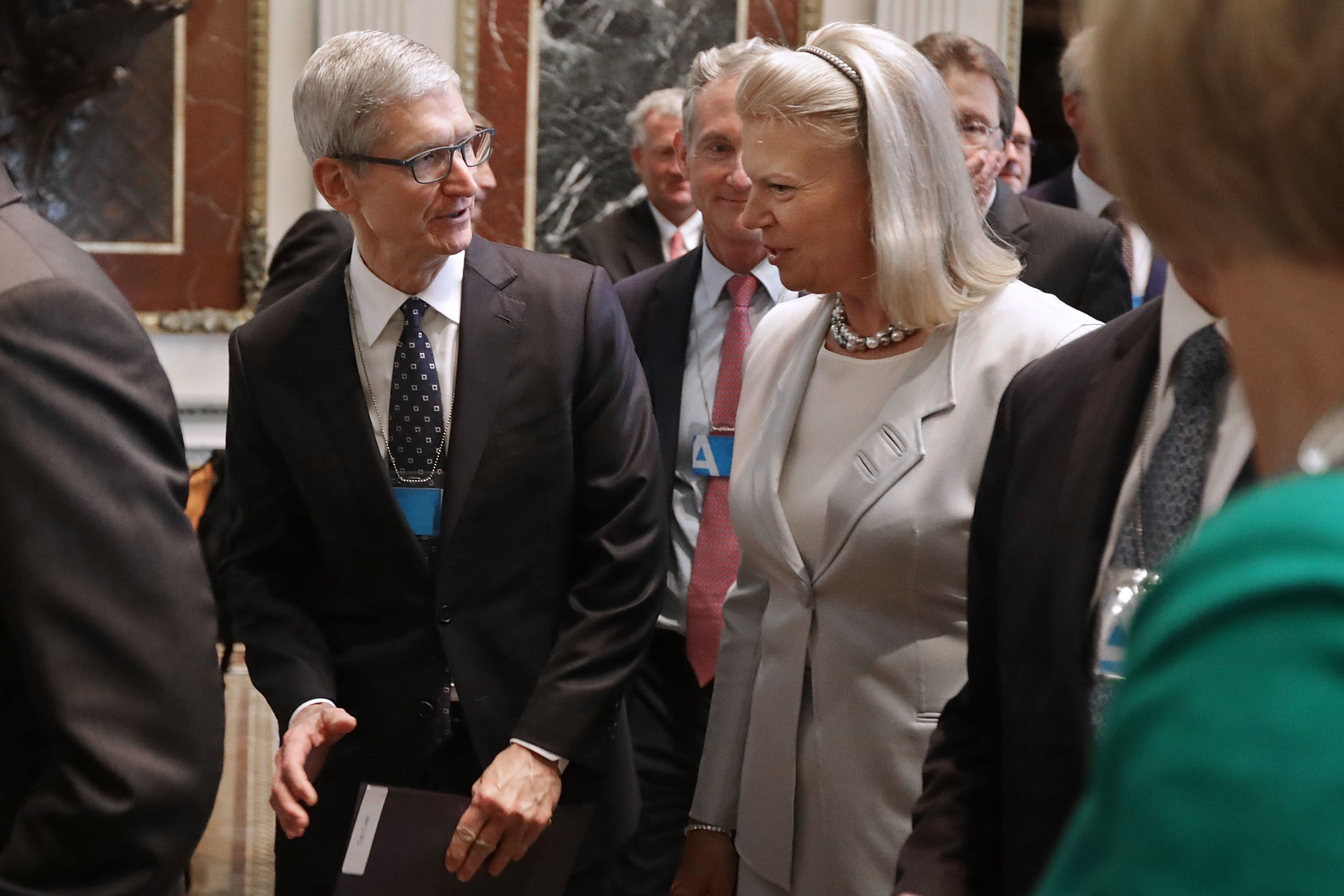 WASHINGTON, DC - JUNE 19: Apple CEO Tim Cook (L) and IBM CEO Ginni Rometty attend the inaugural meeting of the American Technology Council in the Indian Treaty Room at the Eisenhower Executive Office Building next door to the White House June 19, 2017. (Chip Somodevilla/Getty Images)