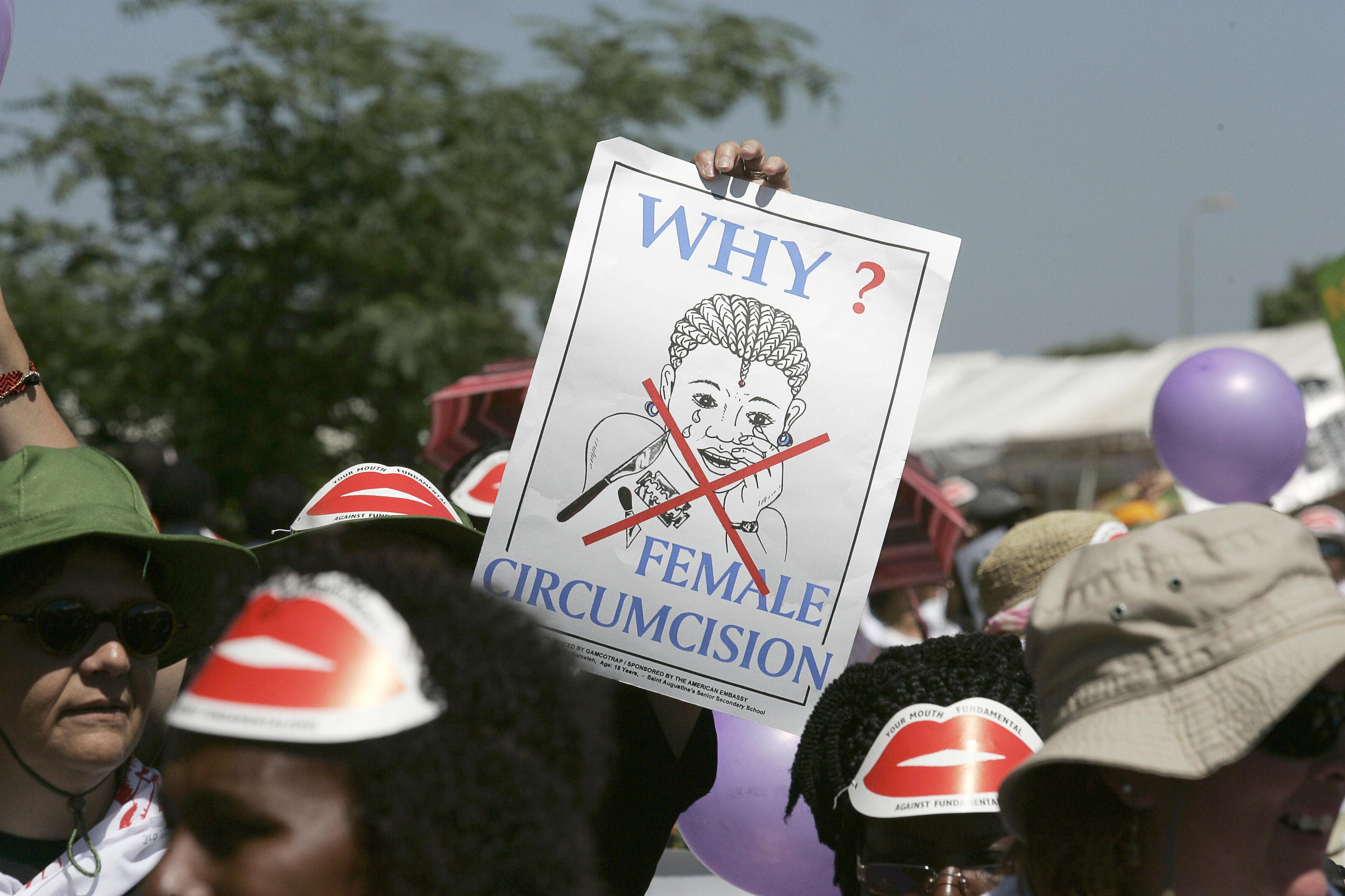 Nairobi, KENYA: Members of African Gay and Lesbian communities demonstrate against female genital mutilation. (Photo credit should read MARCO LONGARI/AFP/Getty Images)