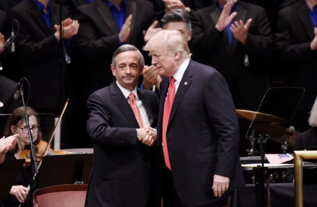 WASHINGTON, DC - JULY 01: (AFP OUT) US President Donald Trump is greeting by Pastor Robert Jeffress during the Celebrate Freedom Rally at the John F. Kennedy Center for the Performing Arts on July 1, 2017 in Washington, DC. (Photo by Olivier Douliery-Pool via Getty Images)