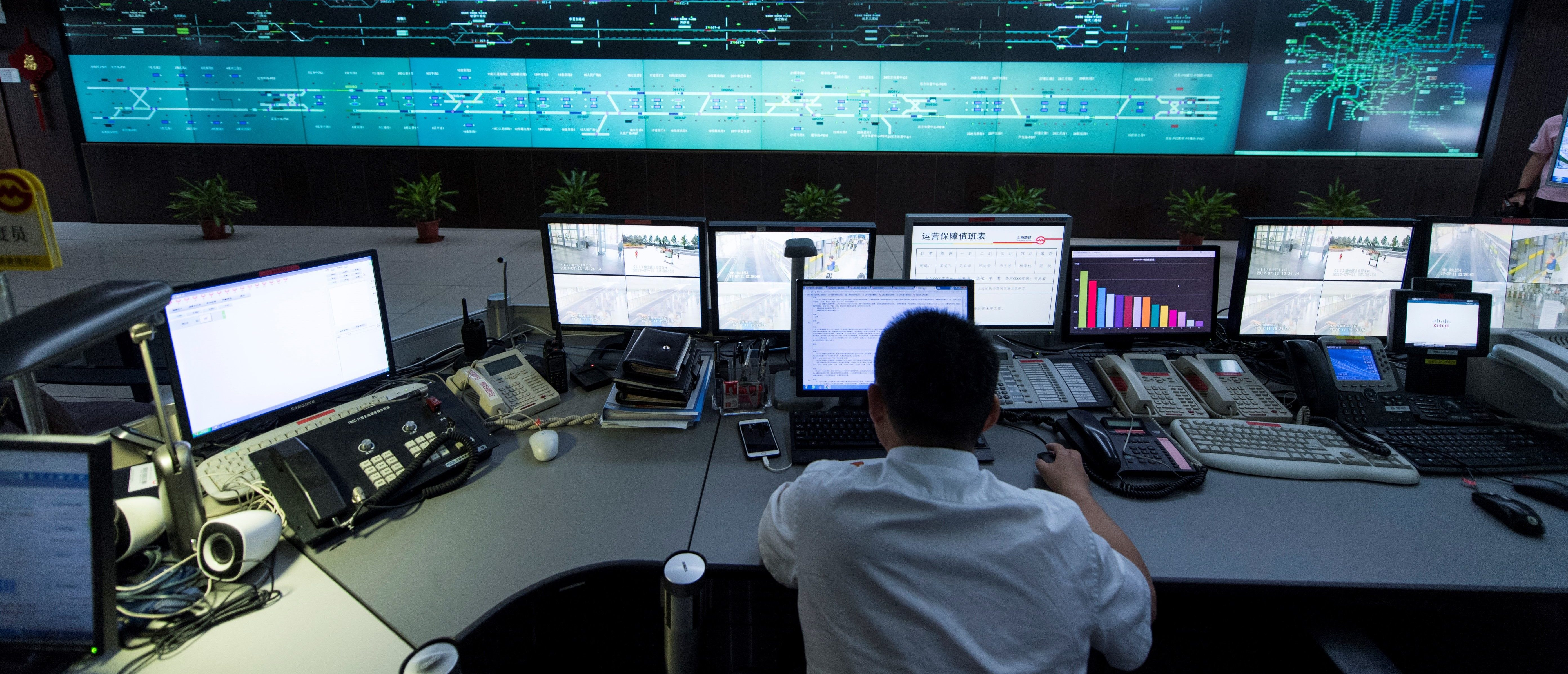 This picture taken on July 11, 2017 shows a man working at the central command centre of the Shanghai metro system. (JOHANNES EISELE/AFP/Getty Images)
