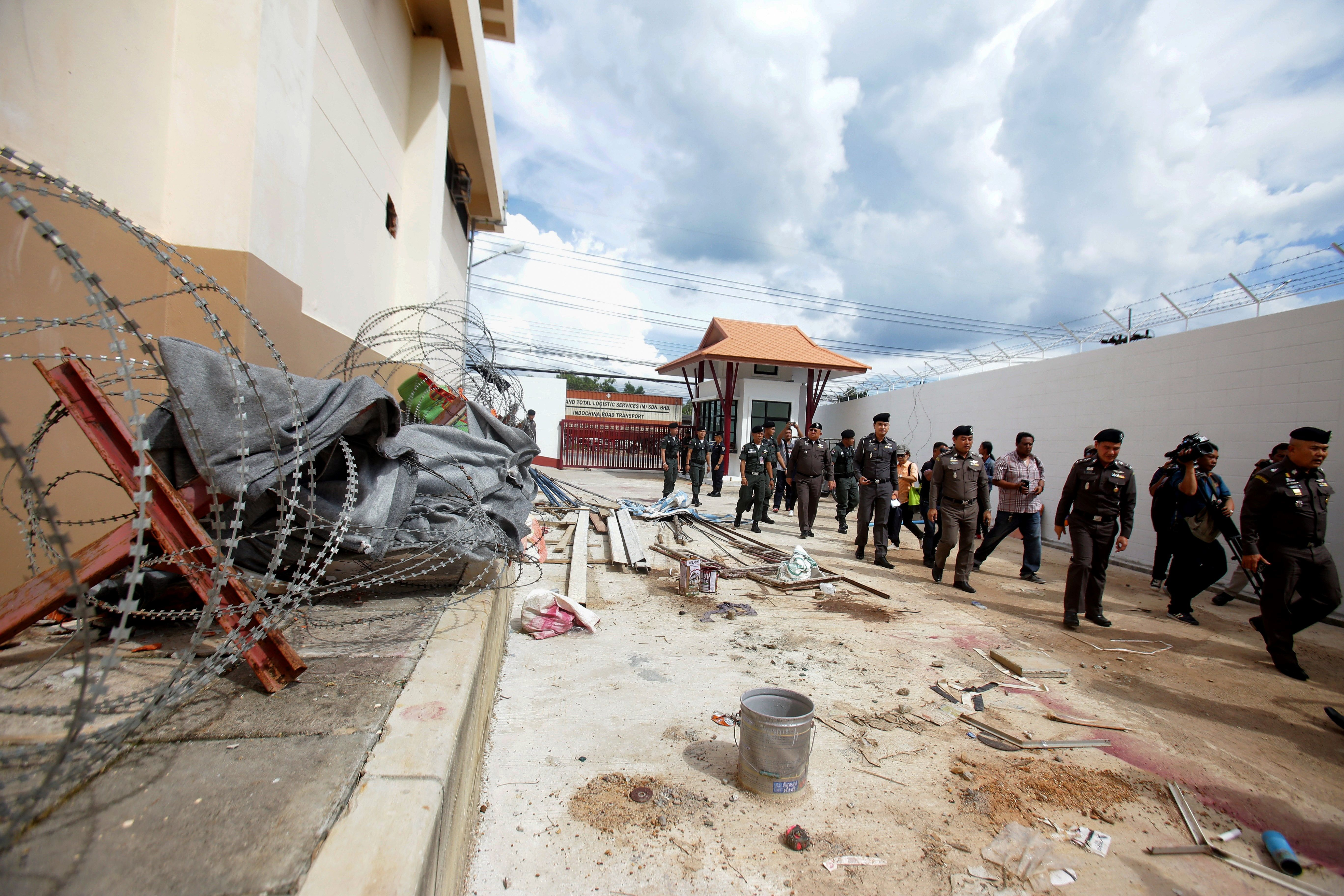 Police inspect the exterior of an immigration detention centre, from where 20 ethnic Uighurs escaped on Monday morning, in Sadao district in the southern Thai province of Songkhla on November 21, 2017. (TUWAEDANIYA MERINGING/AFP/Getty Images)