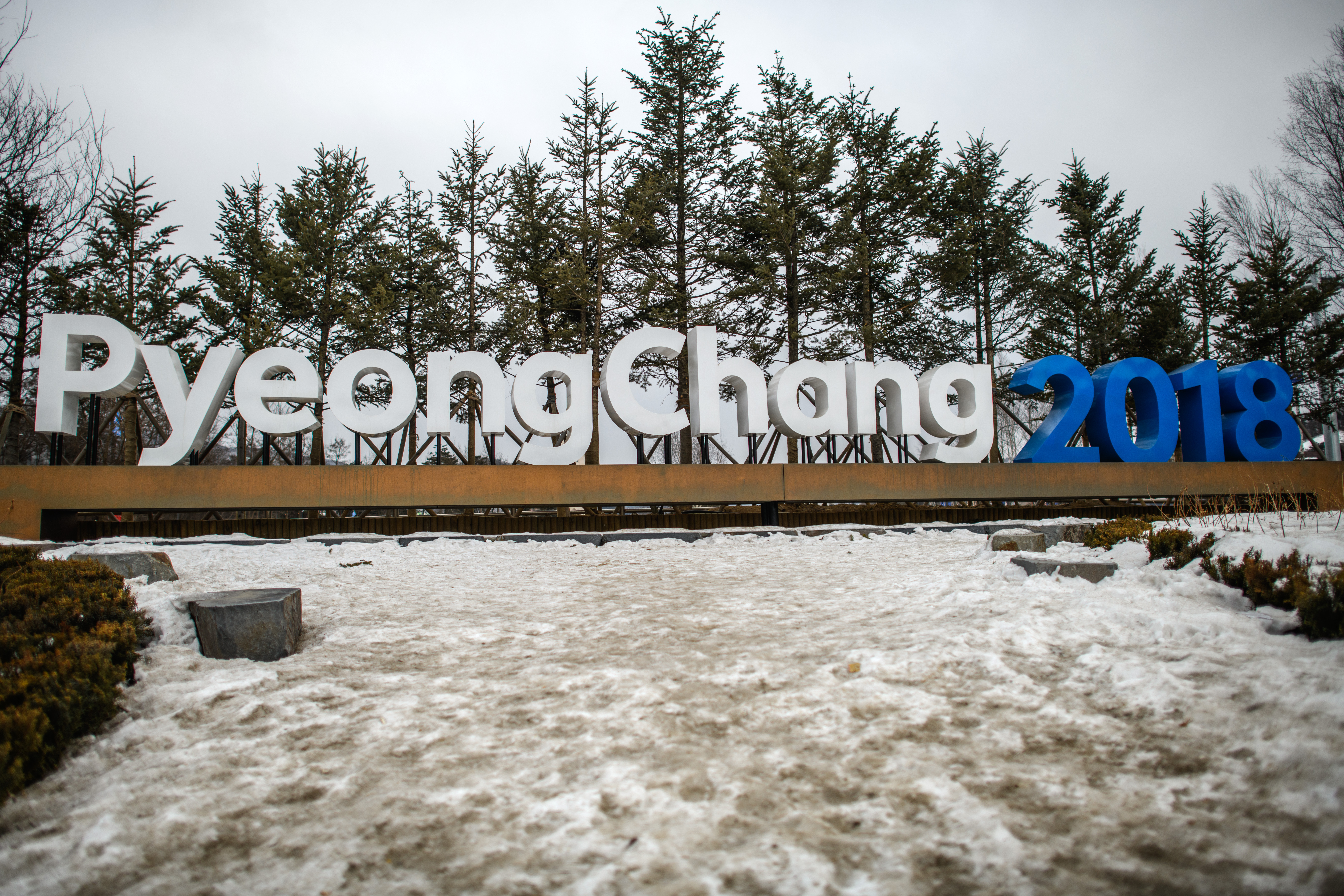 PYEONGCHANG-GUN, SOUTH KOREA - A sign for the PyeongChang 2018 Winter Olympics is displayed by a road leading into PyeongChang, on February 11, (Carl Court/Getty Images)