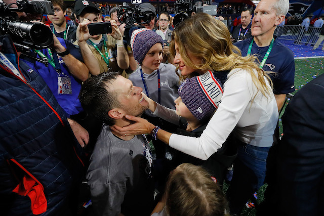 Tom Brady #12 of the New England Patriots celebrates with his wife Gisele Bündchen after the Super Bowl LIII against the Los Angeles Rams at Mercedes-Benz Stadium on February 3, 2019 in Atlanta, Georgia. The New England Patriots defeat the Los Angeles Rams 13-3. (Photo by Kevin C. Cox/Getty Images)