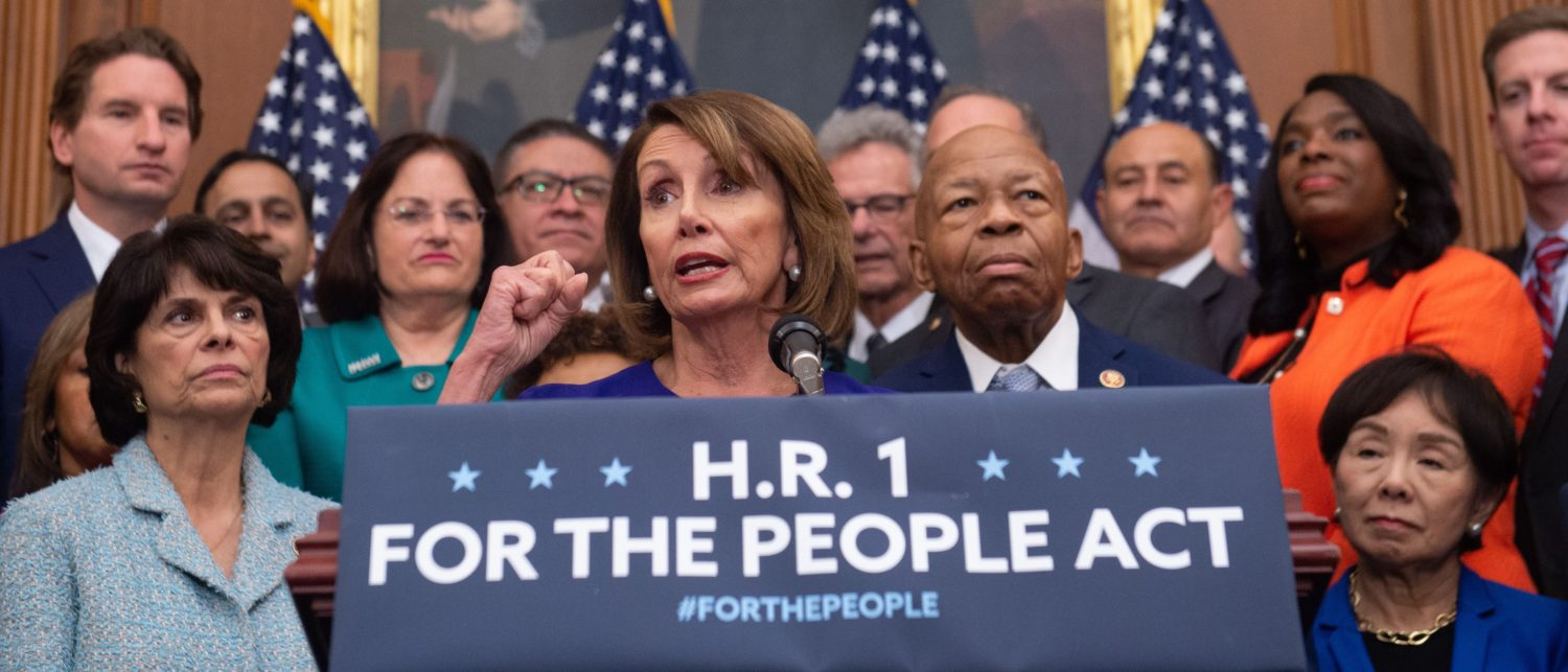 "US Speaker of the House Nancy Pelosi (C), Democrat of California, speaks alongside Democratic members of the House about H.R.1, the ""For the People Act,"" at the US Capitol in Washington, DC, January 4, 2019. - Democrats announced their first piece of legislation to reform voting rights provisions, ethics reforms and a requirement that presidential candidates release 10 years of tax returns. (Photo by SAUL LOEB / AFP) (Photo credit should read SAUL LOEB/AFP/Getty Images)"