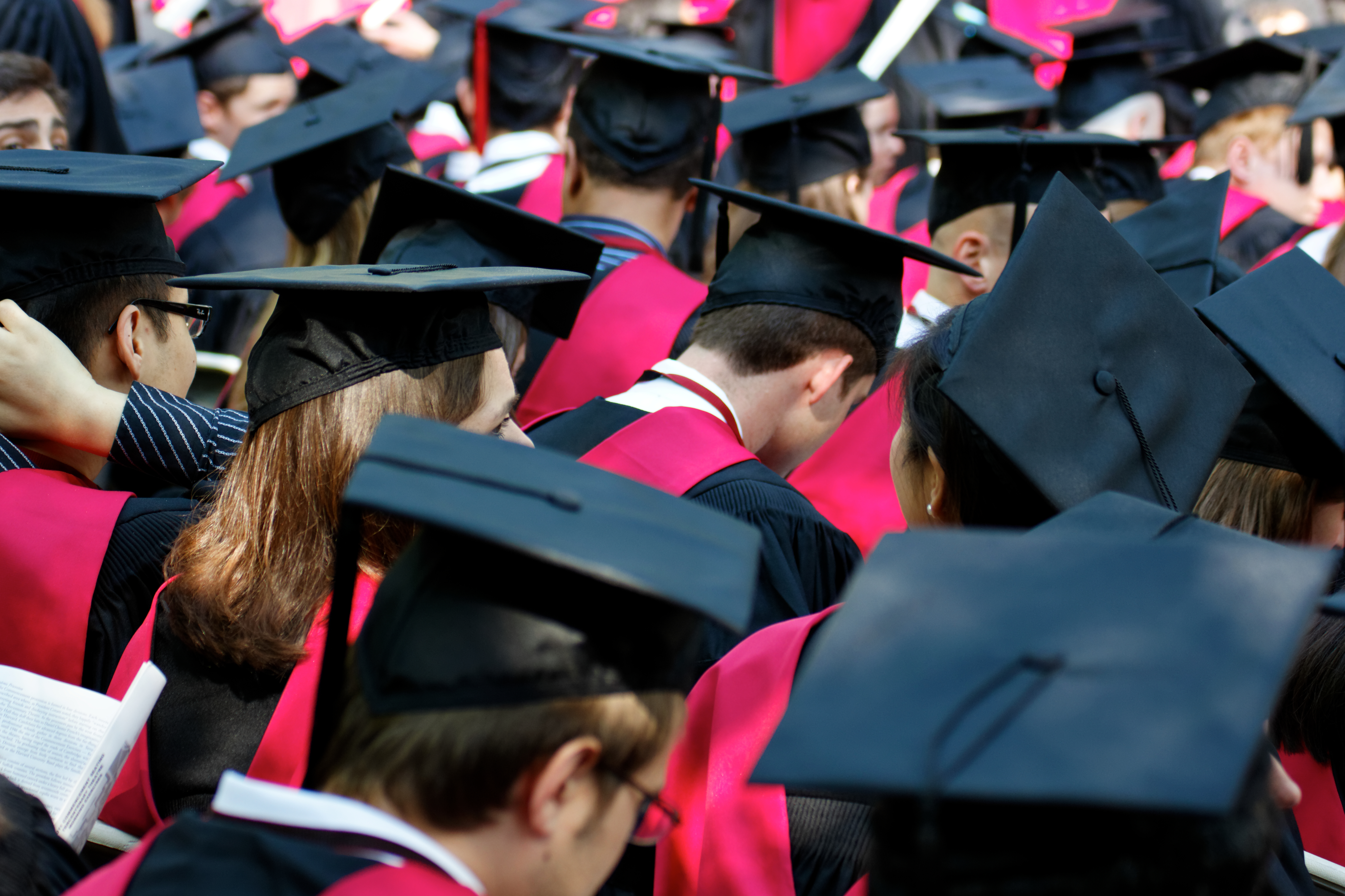 Pictured are Harvard students waiting to graduate. SHUTTERSTOCK/ Jannis Tobias Werner