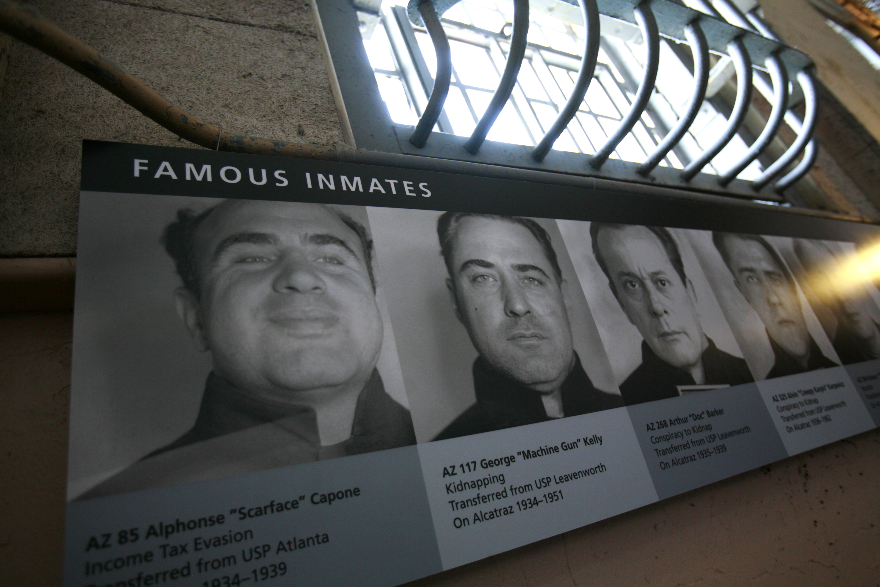 "Photographs of infamous criminals, including Al Capone (L) and George ""Machine Gun"" Kelly are shown on a wall along cell block ""D"" at Alcatraz Island in San Francisco Bay in San Francisco, California, August 9, 2009. The U.S. National Park Service on Sunday commemorated the 75th anniversary of Alcatraz as a federal prison. REUTERS/Robert Galbraith"