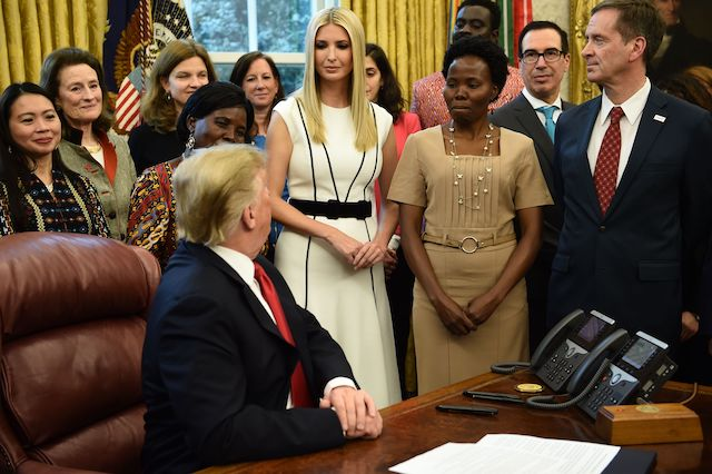 US President Donald Trump looks at his daughter Ivanka Trump as he participates in the National Security Presidential Memorandum to launch the Womens Global Development and Prosperity (W-GDP) Initiative in the Oval Office at the White House in Washington, DC, on February 7, 2019. (Photo credit: BRENDAN SMIALOWSKI/AFP/Getty Images)
