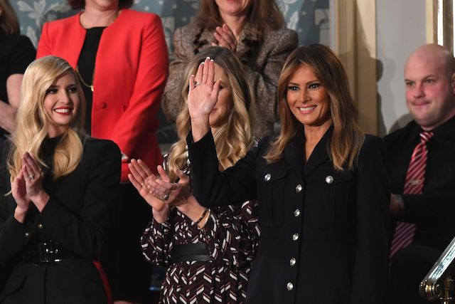 US First Lady Melania Trump (R) waves, flanked by Senior Advisor to the President Ivanka Trump (L), as she arrives to attend the State of the Union address at the US Capitol in Washington, DC, on February 5, 2019. (Photo credit: SAUL LOEB/AFP/Getty Images)