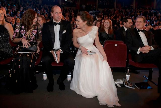 Britain's Prince William, Duke of Cambridge (L) and Britain's Catherine, Duchess of Cambridge arrive for the BAFTA British Academy Film Awards at the Royal Albert Hall in London on February 10, 2019. (Photo credit: TIM IRELAND/AFP/Getty Images)