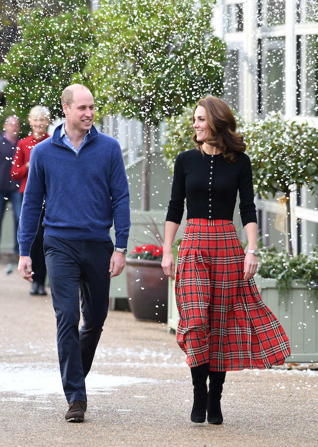 Prince William, Duke of Cambridge and Catherine, Duchess of Cambridge laugh as a machine sprays snow ahead of their royal highnesses hosting a Christmas party to deliver a message of support to deployed personnel serving in Cyprus and their families over the festive period, at Kensington Palace on December 04, 2018 in London, England. Approximately 7,500 military personnel are currently serving overseas at Christmas. (Photo by Stuart C. Wilson/Getty Images)