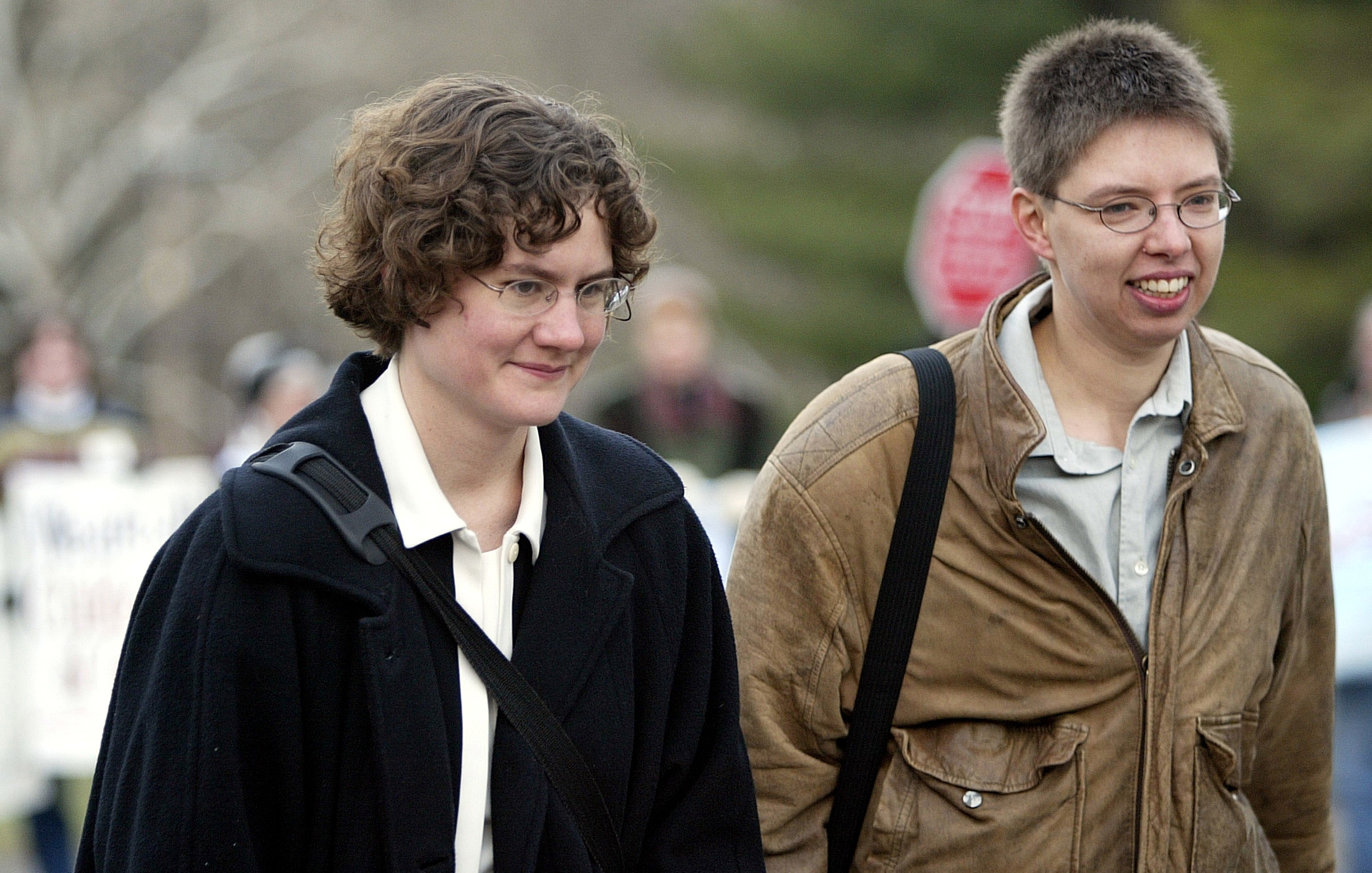 Rev. Irene Elizabeth Stroud (L) walks with her partner, Chris Paige, toward the gymnasium at Camp Innabah on the second day of Stroud's trial in Pughtown, Pennsylvania, December 2, 2004. Stroud, a Methodist minister facing a church trial for being a practicing homosexual said on Wednesday that she believes God created her as a lesbian but she does not expect to keep her job. - Getty