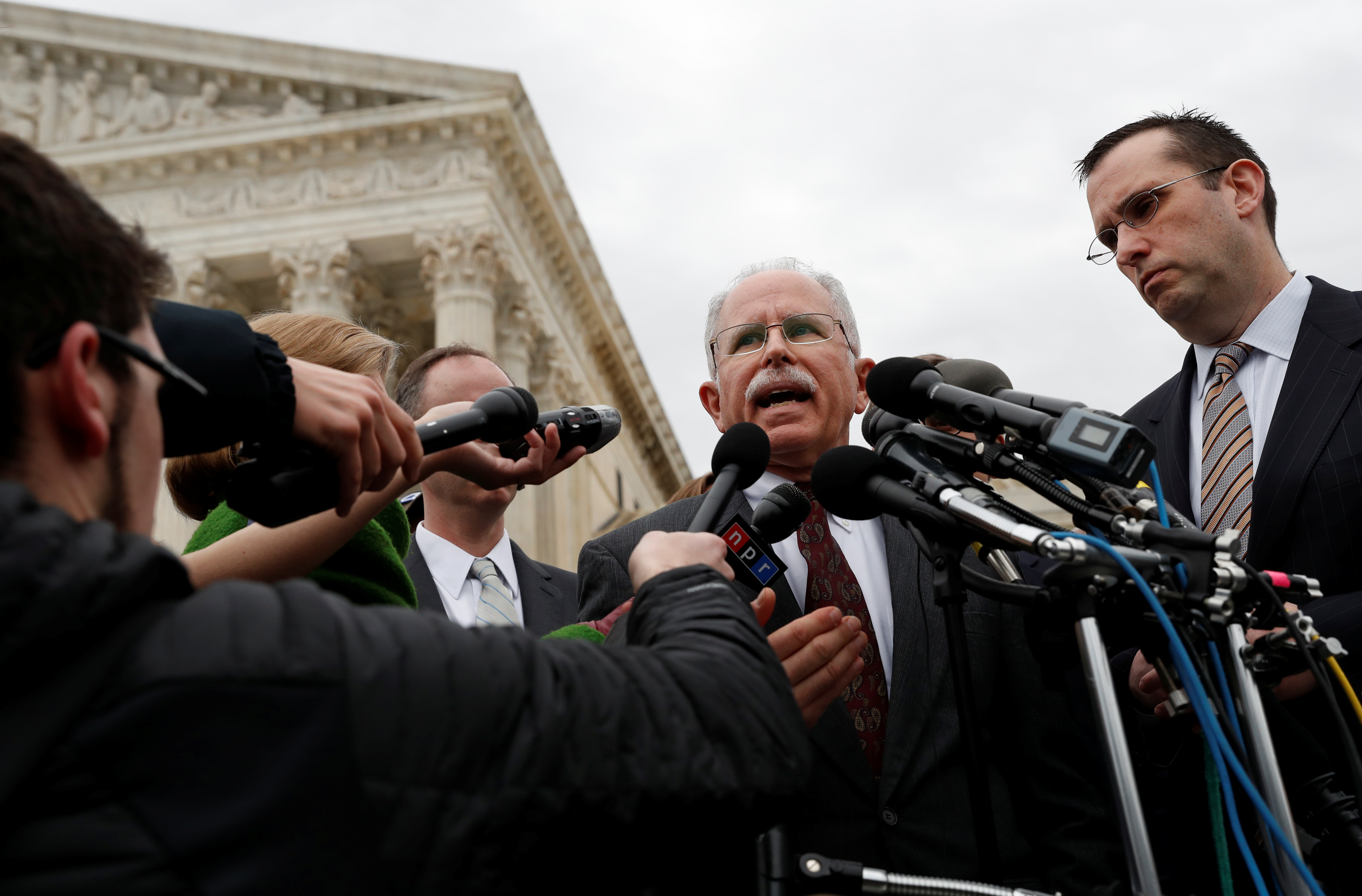 Mark Janus addresses the news media outside of the United States Supreme Court in Washington, U.S., February 26, 2018. REUTERS/Leah Millis