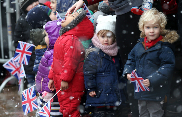 Children wait for the arrival of Britain's Prince Harry, Duke of Sussex and Meghan, Duchess of Sussex at Bristol Old Vic in Bristol, Britain, February 1, 2019. REUTERS/Tom Jacobs