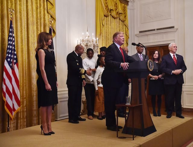 US President Donald Trump and first lady Melania host a White House reception in honor of National African American History Month on February 21, 2019 in Washington, DC. (Photo credit: NICHOLAS KAMM/AFP/Getty Images)