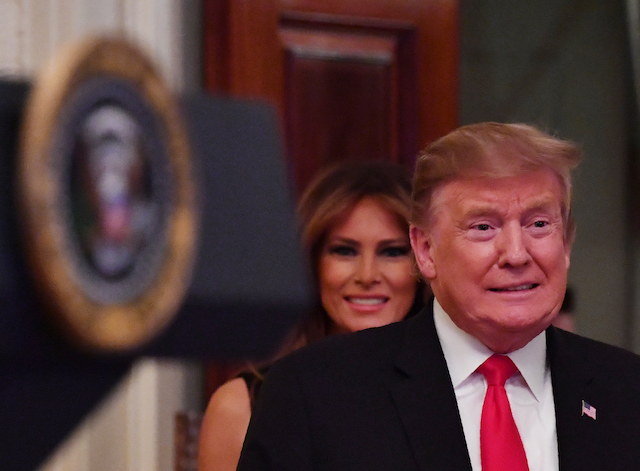 US President Donald Trump and first lady Melania arrive for a White House reception in honor of National African American History Month on February 21, 2019 in Washington, DC. (Photo credit: NICHOLAS KAMM/AFP/Getty Images)