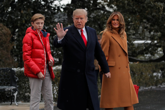 U.S. President Donald Trump walks with first lady Melania Trump and son Barron while departing for Palm Beach, Florida from the White House in Washington, U.S., February 1, 2019. REUTERS/Jim Young