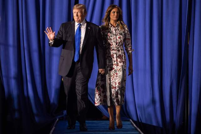 US President Donald Trump and First Lady Melania Trump arrive to deliver remarks to the Venezuelan American community at Florida International University Ocean Bank Convocation Center in Miami, FL, on February 18, 2019. (Photo credit: JIM WATSON/AFP/Getty Images)