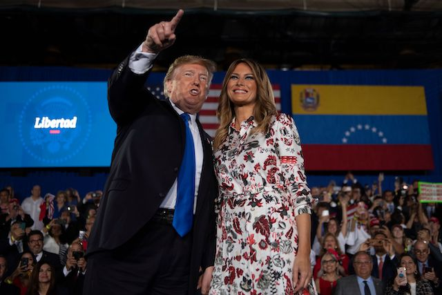 US President Donald Trump and First Lady Melania Trump deliver remarks to the Venezuelan American community at Florida International University Ocean Bank Convocation Center in Miami, FL, on February 18, 2019. (Photo credit: JIM WATSON/AFP/Getty Images)