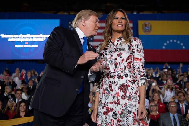 US President Donald Trump (L) and First Lady Melania Trump arrive to deliver remarks to the Venezuelan American community at Florida International University Ocean Bank Convocation Center in Miami, FL, on February 18, 2019. (Photo credit: JIM WATSON/AFP/Getty Images)