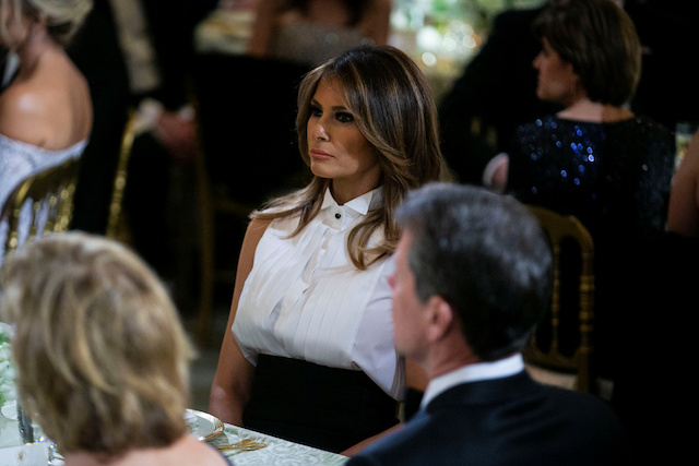 First lady Melania Trump listens as U.S. President Donald Trump (not pictured) speaks at the Governors' Ball, in the State Dining Room of the White House, in Washington, U.S., February 24, 2019. REUTERS/Al Drago