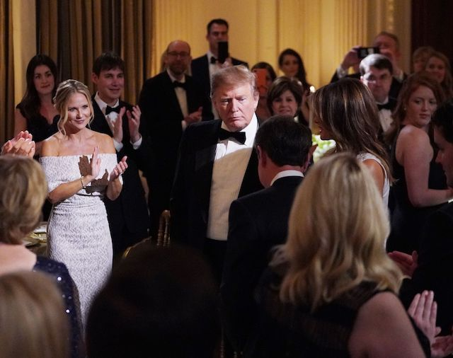 US President Donald Trump (C) and First Lady Melania Trump arrive for the Governors' Ball at the White House in Washington, DC on February 24, 2019. (Photo credit: MANDEL NGAN/AFP/Getty Images)
