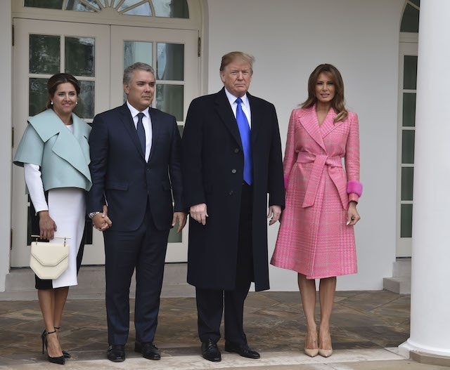 US President Donald Trump and First Lady Melania Trump greet Colombian President Ivan Duque(2ndL) and his wife Maria Ruiz(L) at the White House in Washington, DC, on February 13, 2019. - President Donald Trump hosted his Colombian counterpart Ivan Duque at the White House on Wednesday to discuss their campaign to pressure Venezuela's far left president, Nicolas Maduro, from power. The Trump-Duque talks in the Oval Office, followed by lunch, will give the allies a chance to compare notes just as the standoff between Maduro and opposition leader Juan Guaido heats up over the arrival of mostly US aid shipments. (Photo credit: NICHOLAS KAMM/AFP/Getty Images)