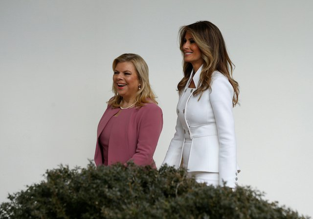 U.S. first lady Melania Trump (R) escorts Sara Netanyahu along the Colonnade at the White House in Washington, U.S. February 15, 2017. REUTERS/Kevin Lamarque