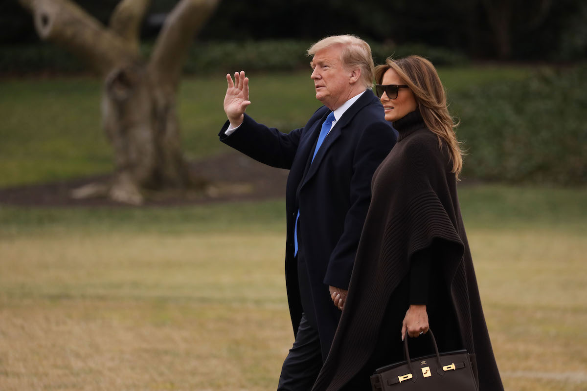 U.S. President Donald Trump and first lady Melania Trump walk towards the Marine One on the South Lawn of the White House prior to their departure on February 15, 2019 in Washington, DC. Earlier, President Trump declared a national emergency to build a wall on the border. He and the first lady are traveling to his Mar-a-Lago resort in Palm Beach, Florida for the weekend. (Photo by Alex Wong/Getty Images)