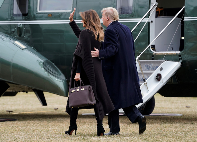 U.S. President Donald Trump and U.S. first lady Melania Trump walk to Marine One as they depart for Palm Beach from the White House in Washington, U.S., February 15, 2019. REUTERS/Joshua Roberts