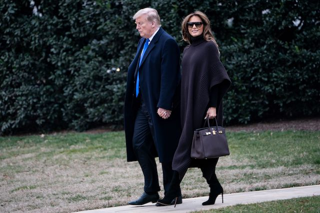 US President Donald Trump and US first lady Melania Trump walk to Marine One on the South Lawn of the White House February 15, 2019 in Washington, DC. - Trump is spending the weekend at his Mar-a-Lago estate in Palm Beach, Florida. (Photo credit: BRENDAN SMIALOWSKI/AFP/Getty Images)