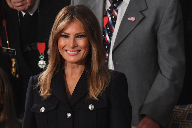 US First Lady Melania Trump smiles as she arrives to attend the State of the Union address at the US Capitol in Washington, Photo credit: SAUL LOEB/AFP/Getty Images)