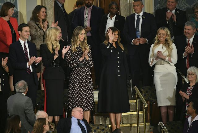 First Lady Melania Trump greets the audience, surrounded by family members, as she arrives for US President Donald Trump's State of the Union address at the US Capitol in Washington, DC on February 5, 2019. (Photo credit: MANDEL NGAN/AFP/Getty Images)
