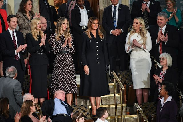 First Lady Melania Trump (C) is greeted by the audience, surrounded by family members (from L-R, Jared Kushner and Ivanka Trump, Lara Trump and Tiffany Trump), as she arrives for US President Donald Trump's State of the Union address at the US Capitol in Washington, DC on February 5, 2019. (Photo credit: MANDEL NGAN/AFP/Getty Images)