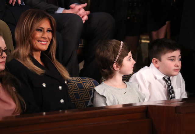 U.S. first lady Melania Trump sits with her guests, young cancer survivor Grace Eline (C) and Joshua Trump (R), a 6th grade student from Delaware who has been bullied because of his last name, in the first ladies box as they attend U.S. President Donald Trump's second State of the Union address to a joint session of the U.S. Congress in the House Chamber of the U.S. Capitol on Capitol Hill in Washington, U.S. February 5, 2019. REUTERS/Jonathan Ernst