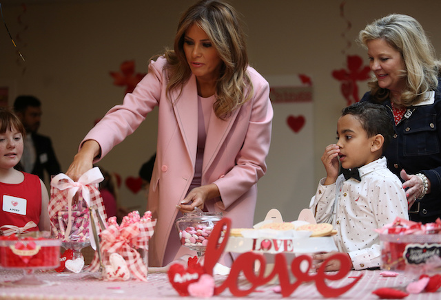 U.S. first lady Melania Trump makes fills Valentines Day boxes with candy with 10-year-old immunedeficiency patient Avery (L) from Festus, Missouri and 9-year-old Josue (R) of Puerto Rico as she visits with children during a Valentineís Day visit with young patients at the Children's Inn at the National Institutes of Health (NIH) in Bethesda, Maryland, U.S., February 14, 2019. REUTERS/Jonathan Ernst