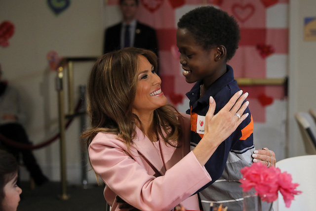 U.S. first lady Melania Trump gets a hug while making candygrams with 13-year-old sickle cell disease sufferer Amani, of Mombasa, Kenya, during a Valentineís Day visit with young patients at the Children's Inn at the National Institutes of Health (NIH) in Bethesda, Maryland, U.S., February 14, 2019. Amani is preparing for a bone marrow transplant. REUTERS/Jonathan Ernst