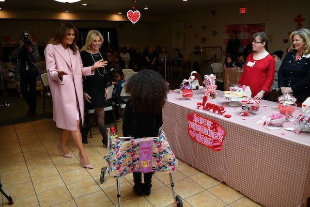 US First Lady Melania Trump visits children to celebrate Valentine's Day at the Children's Inn at the National Institute of Health (NIH) in Bethesda, Maryland, on February 14, 2019. - The Children's Inn at NIH serves as a home for children undergoing medical treatment and their families. (Photo credit: MANDEL NGAN/AFP/Getty Images)