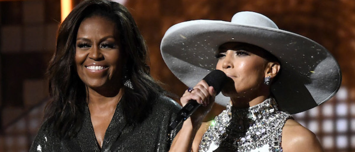Michelle Obama and Jennifer Lopez speak onstage during the 61st Annual GRAMMY Awards at Staples Center on February 10, 2019 in Los Angeles, California. (Photo by Kevork Djansezian/Getty Images)