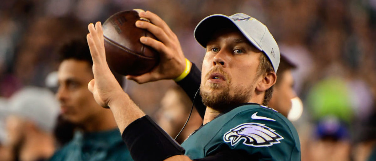 PHILADELPHIA, PA - OCTOBER 07: Quarterback Nick Foles #9 of the Philadelphia Eagles throws a ball on the sidelines as they take on the Minnesota Vikings during the fourth quarter at Lincoln Financial Field on October 7, 2018 in Philadelphia, Pennsylvania. The Vikings won 23-21. (Photo by Corey Perrine/Getty Images)