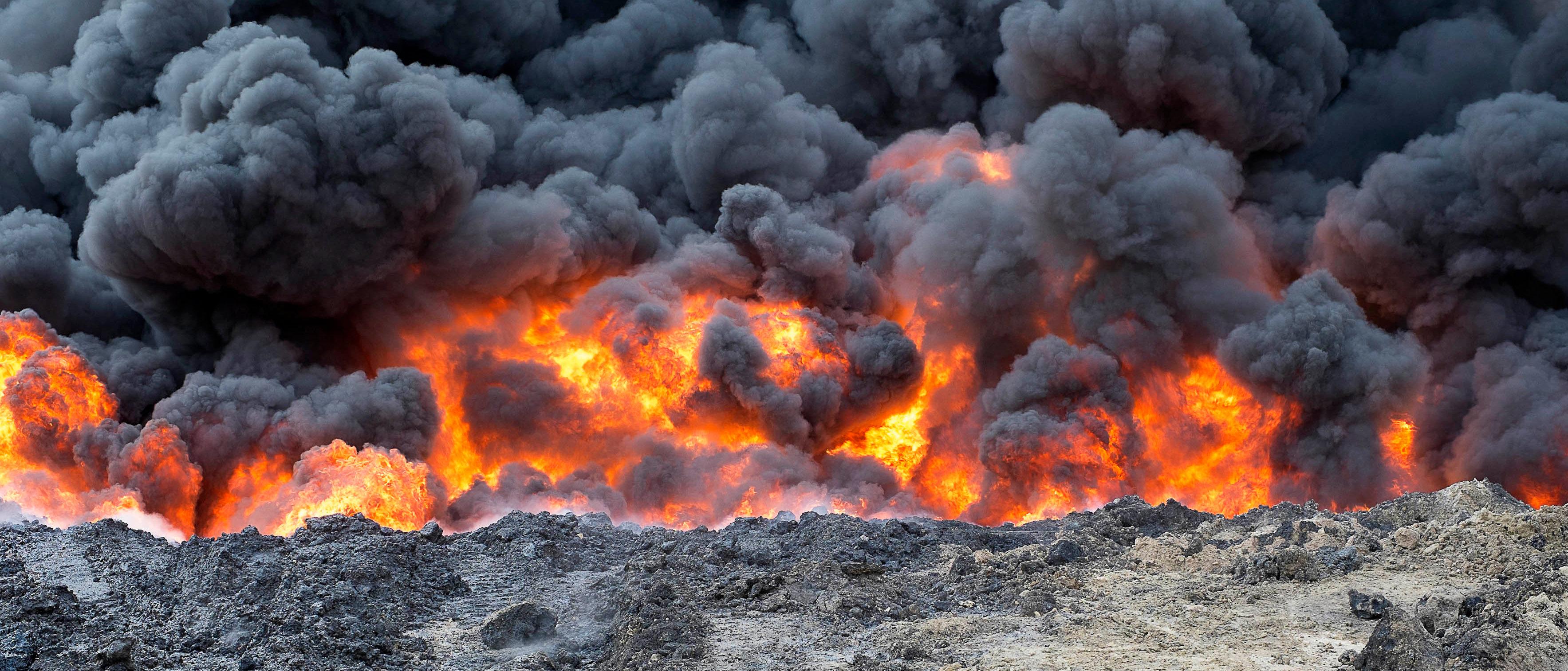 Oil well set fire by ISIS. Shutterstock/cosimoattanasio - Redline