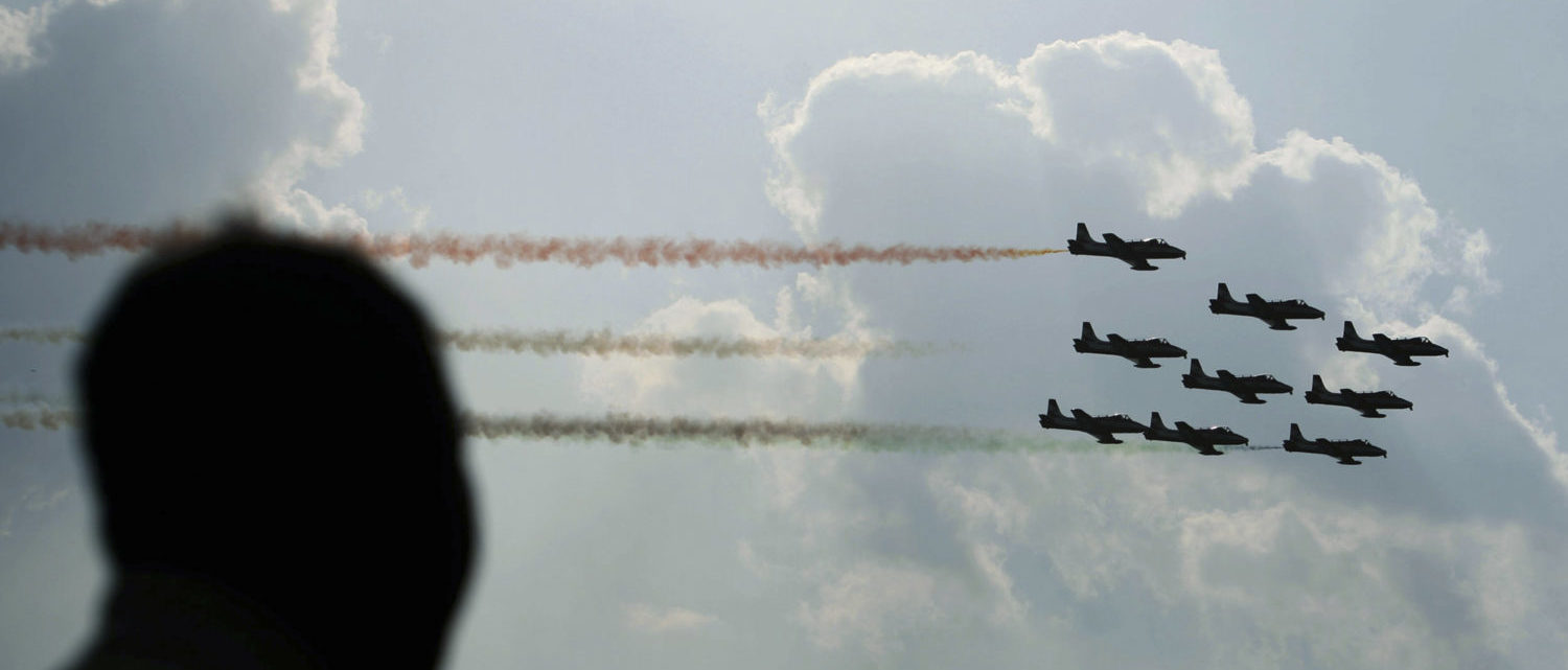 """Pilots from the Surya-Kiran aerobatic demonstration team of the Indian Air Force perform during the """"Aero India 2007"""" air show at the Yelahanka air force station on the outskirts of Bangalore February 11, 2007. REUTERS/Jagadeesh Nv (INDIA)"""
