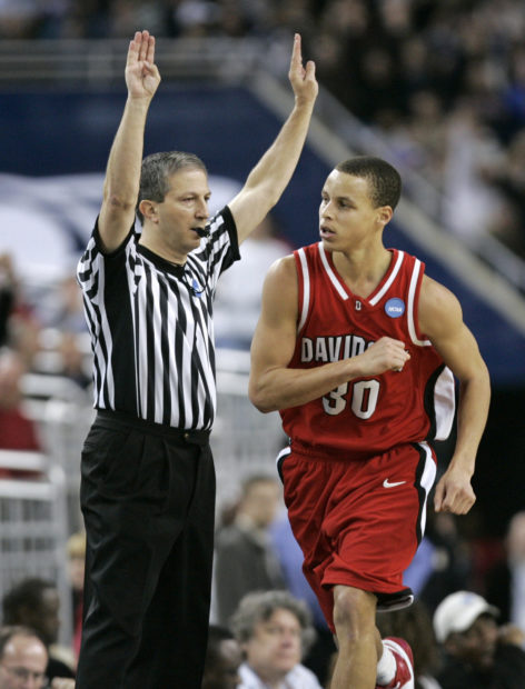 Davidson Wildcats Stephen Curry celebrates after a three point shot against Wisconsin Badgers during NCAA men's basketball game in Detroit