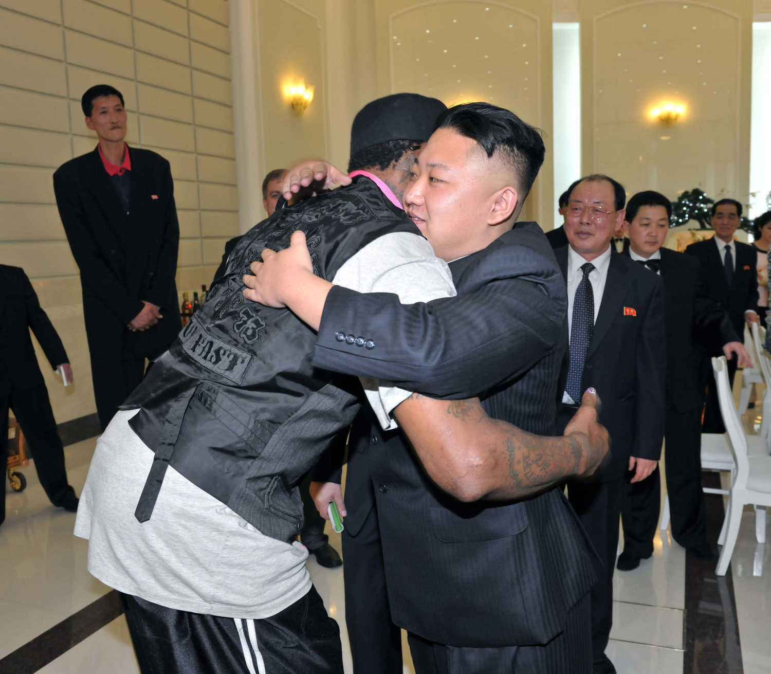 North Korean leader Kim Jong-Un and former NBA basketball player Dennis Rodman (front L) hug in Pyongyang in this undated picture released by North Korea's KCNA news agency on March 1, 2013. REUTERS/KCNA (NORTH KOREA