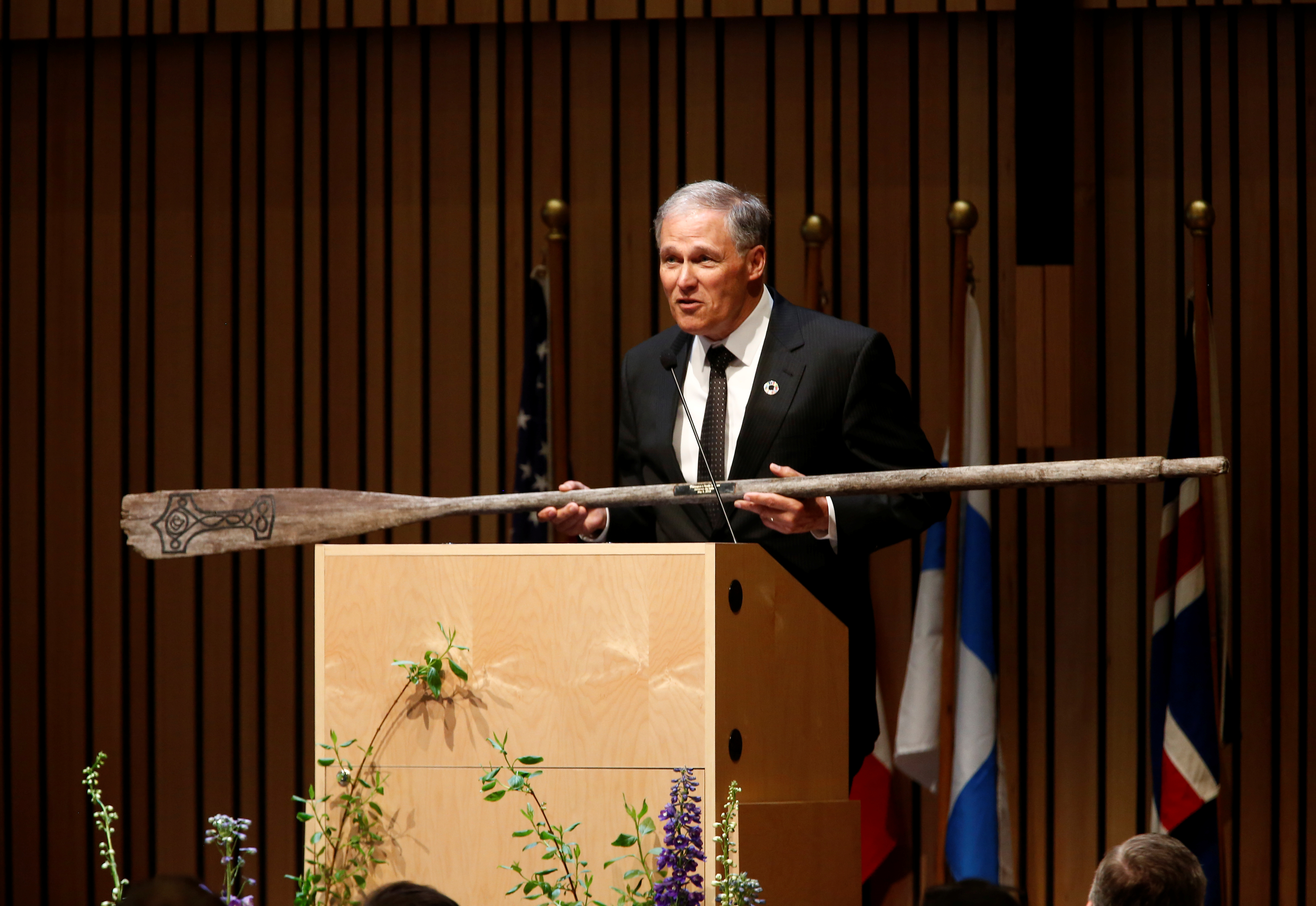 Governor Inslee presents an oar as a gift to the museum during a gala at the Nordic Museum in Seattle