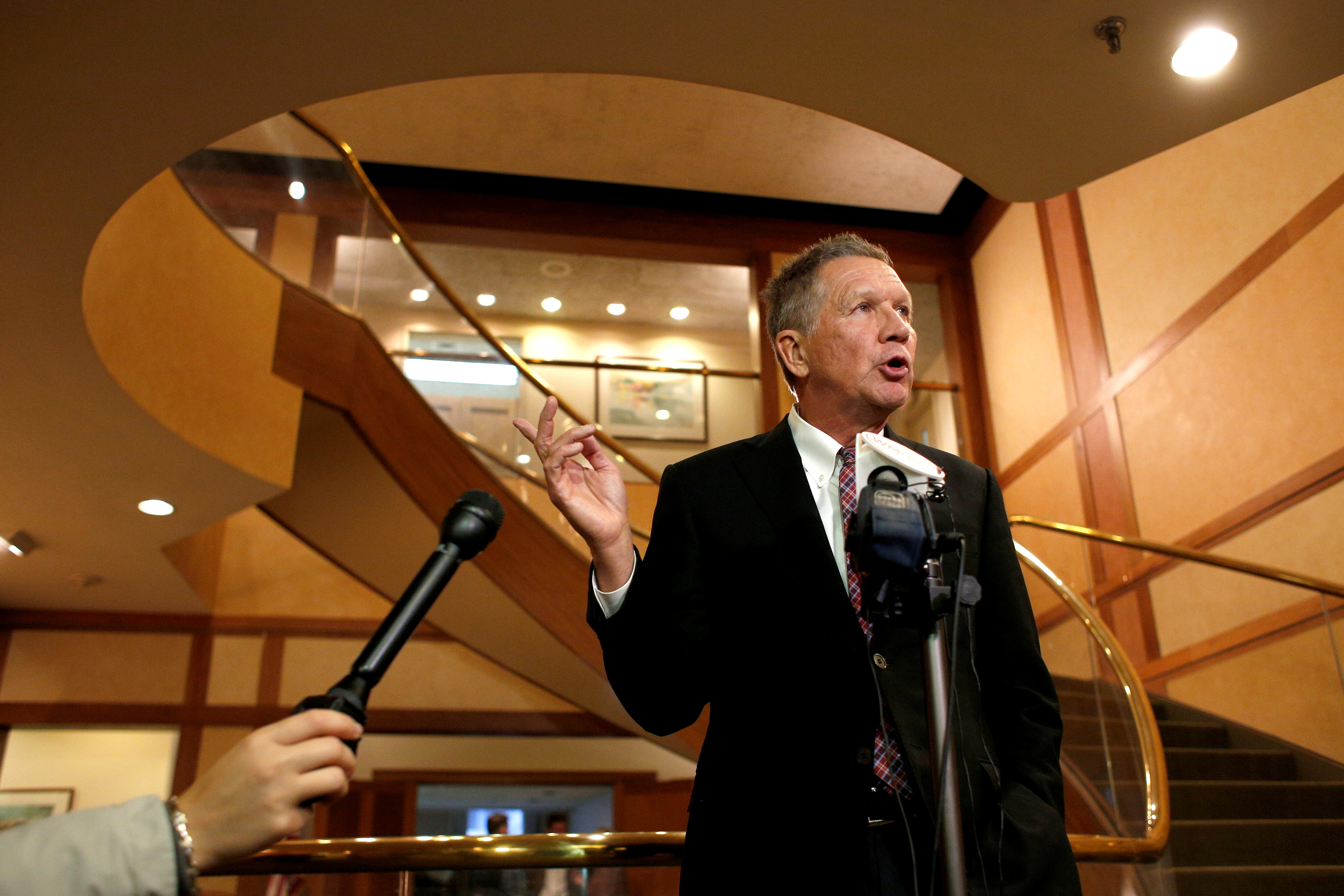 Ohio Governor and former presidential candidate John Kasich speaks to the press in Concord