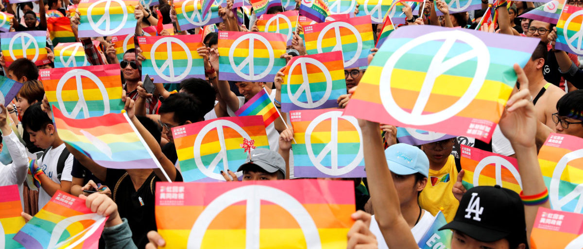 Same-sex marriage supporters take part in a lesbian, gay, bisexual and transgender (LGBT) pride parade after losing in the marriage equality referendum, in Kaohsiung, Taiwan, Nov. 25, 2018. REUTERS/Tyrone Siu