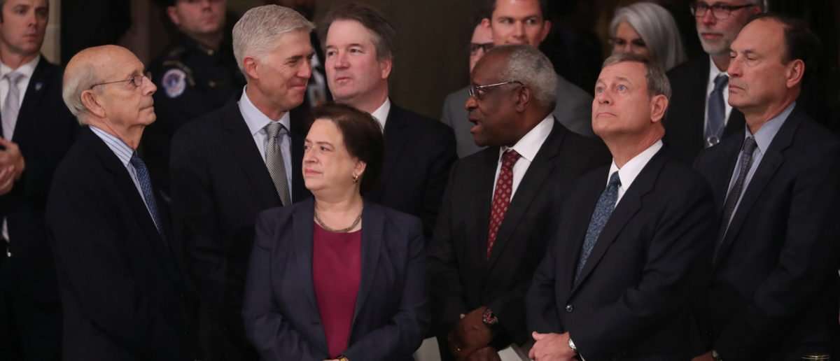 Justices of the U.S. Supreme Court including (L-R) Associate Justices Stephen Breyer, Neil Gorsuch, Elena Kagan, Brett Kavanaugh, Clarence Thomas, Chief Justice John Roberts and Associate Justice Samuel Alito await the arrival of the casket of former U.S. President George H.W. Bush inside the U.S. Capitol Rotunda, where it will lie in state in Washington, U.S., Dec. 3, 2018. REUTERS/Jonathan Ernst/Pool