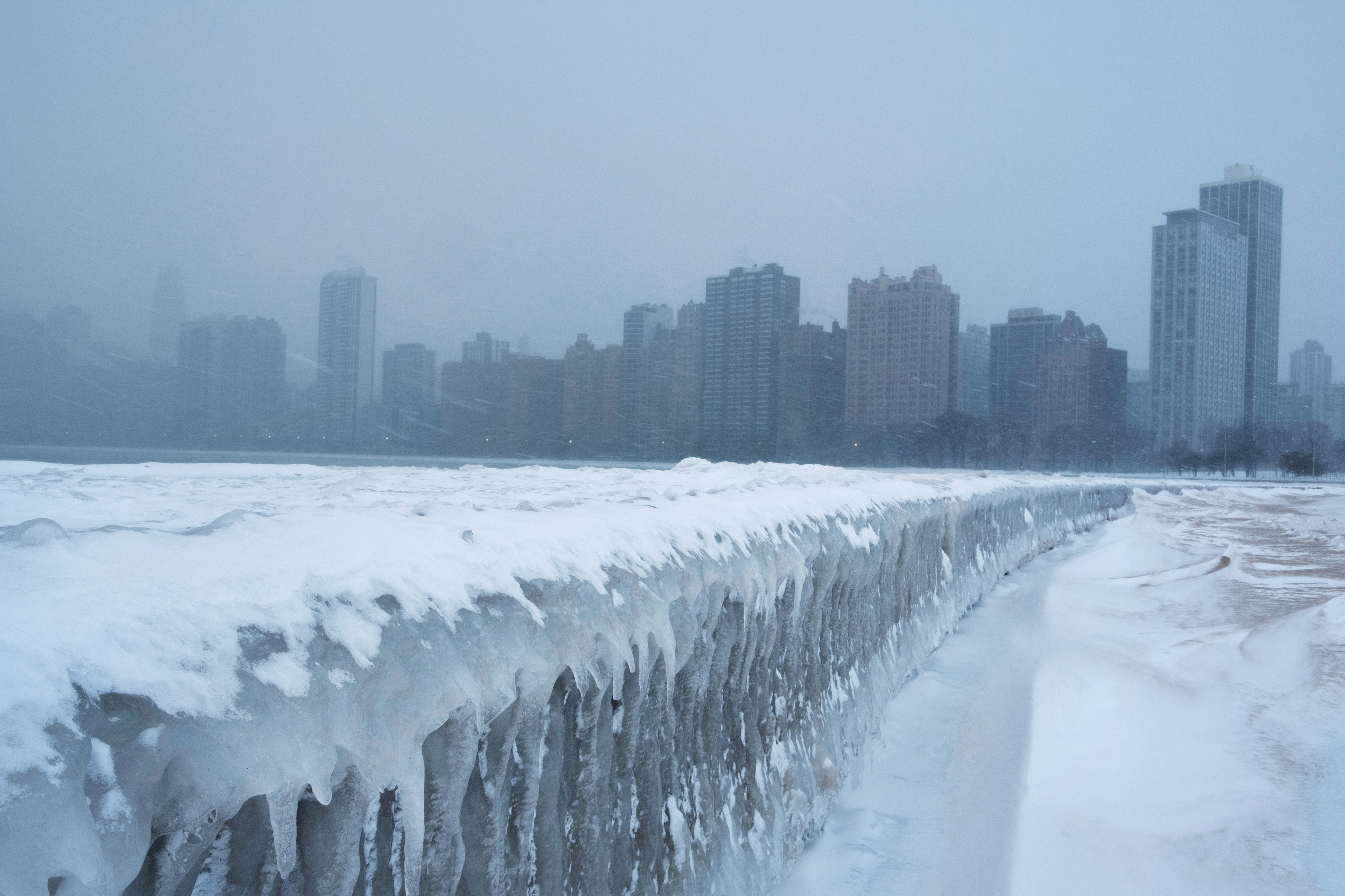 Icicles form on the walkway at North Avenue Beach of Lake Michigan in Chicago