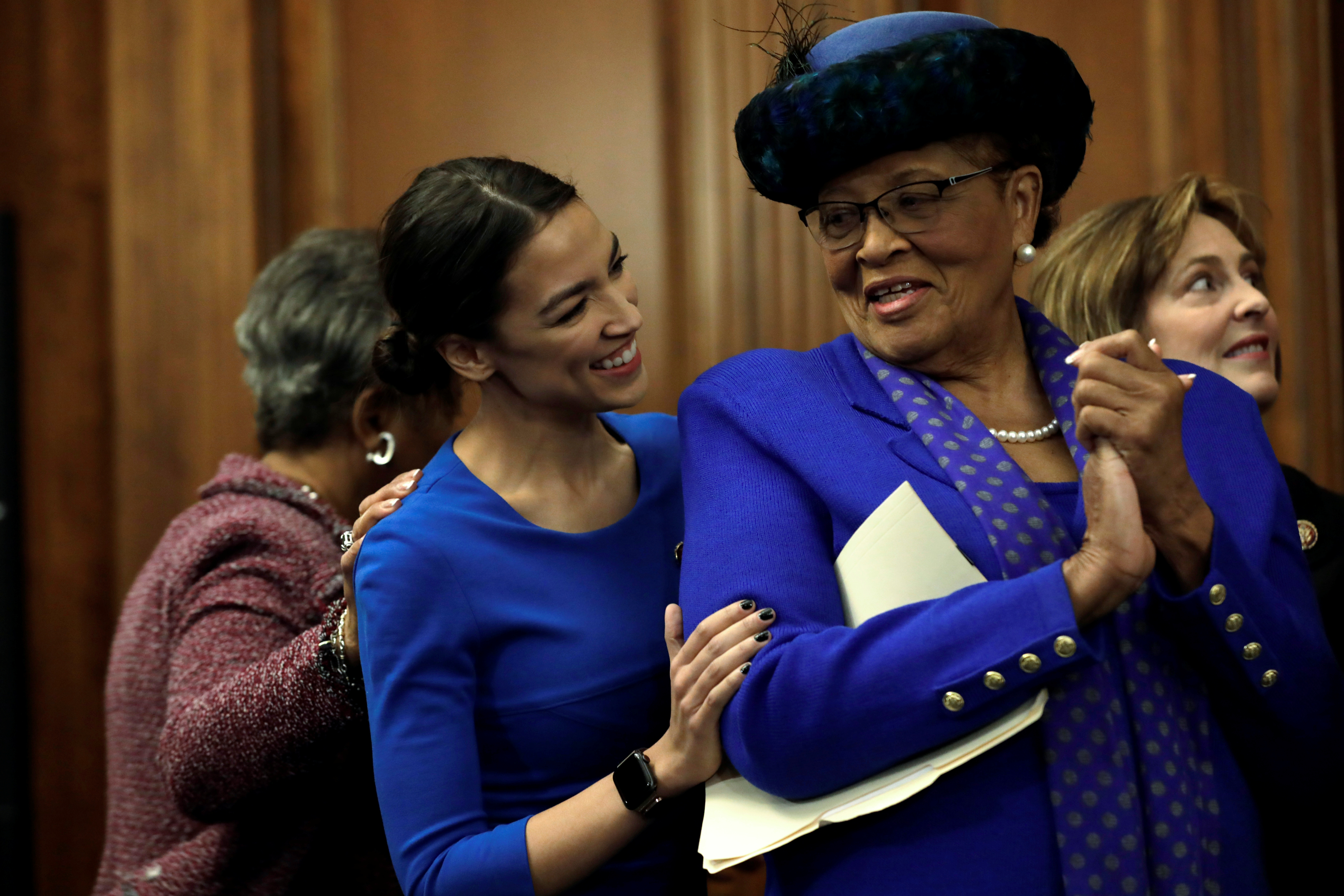 Reps. Alexandria Ocasio Cortez and Rep. Alma Adams react at House Democrats news conferenceon Capitol Hill in Washington