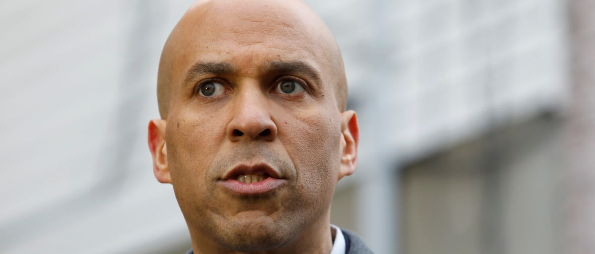 U.S. Senator Cory Booker (D-NJ) speaks to the media outside his home after announcing he will run for president in Newark, New Jersey, U.S., February 1, 2019. REUTERS/Andrew Kelly